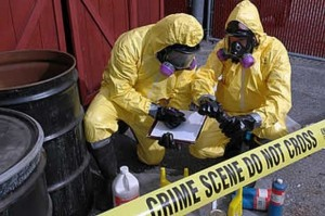 People in toxic waste protective yellow suits and respirators.