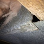 Photo from the crawl space of a Sevierville, TN home shows a gap in the panning of the HVAC return in this home.
